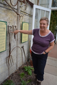 Emma Davies with a fork marked with Charles Gunther's initials - he owned the estate when most of the glasshouses were built