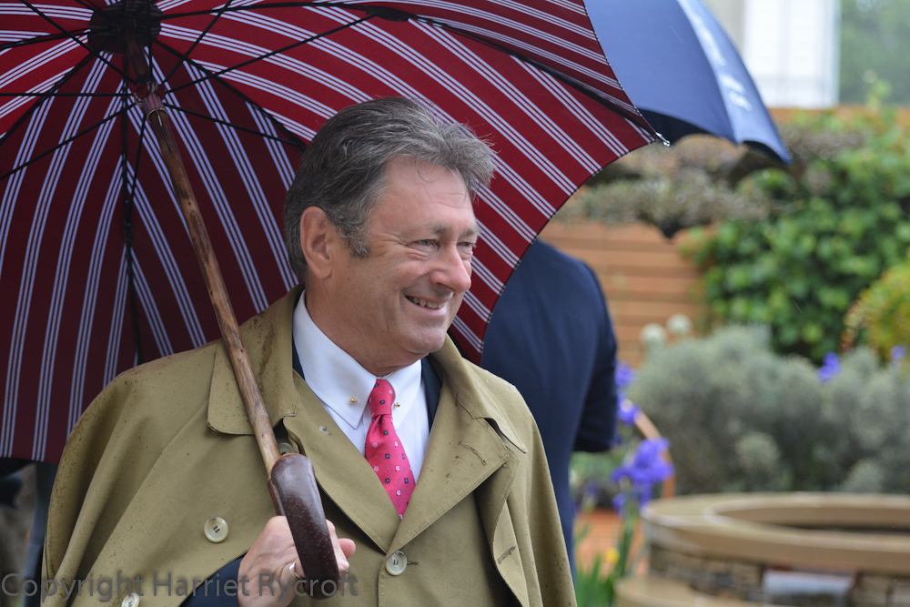 Alan Titchmarsh wins best umbrella at Chelsea. I'm not so sure about that coat.