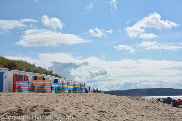 Windbreaks - essential items on most British beaches, even if you are lucky enough to have a beach hut. This is Woolacombe, Devon