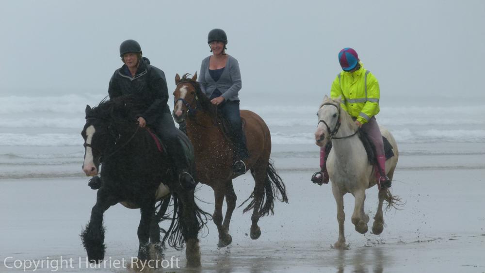 Riding at Druidston Haven, Wales. Fun even in the rain.