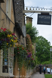 Hanging baskets outside The Eight Bells, Chipping Campden