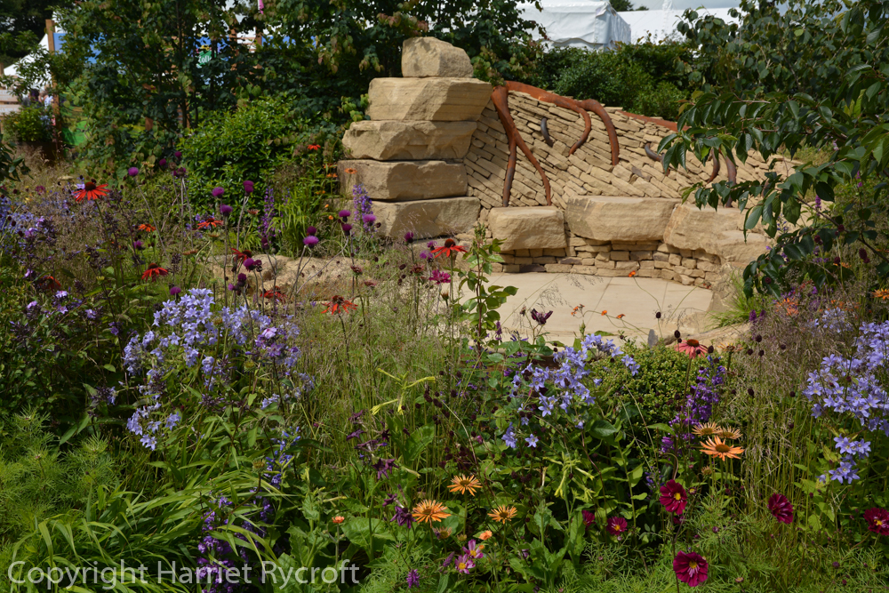 Rusty roots in clever stonework on the Zoflora Outstanding Natural Beauty garden by Helen Elks-Smith